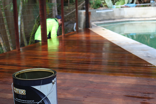 A timber deck stain by SEQ Builders