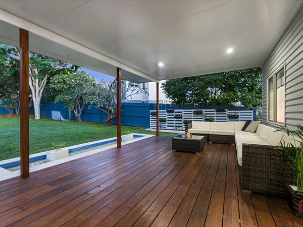 A covered back patio by SEQ Builders