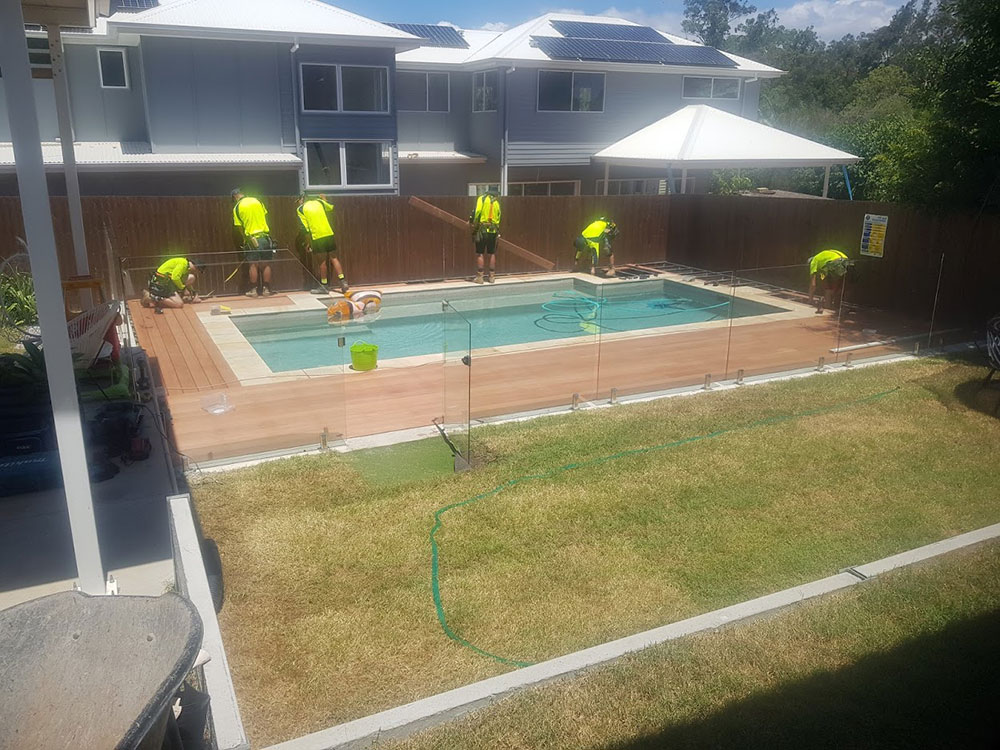 The team at SEQ Builders building a pool patio.